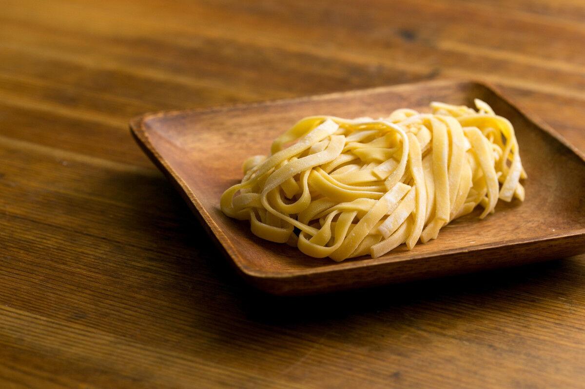 tagAlt.Fresh Pasta Noodles on plate Cover