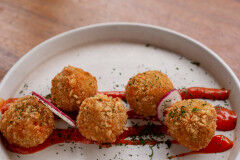 tagAlt.Potato croquettes with mint and pecorino cheese on red pepper cream