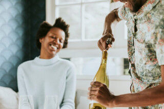 tagAlt.Happy couple opening wine Black Power 2