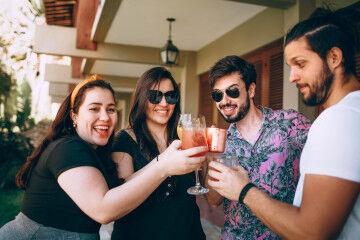 tagAlt.Group of friends having drinks Cover