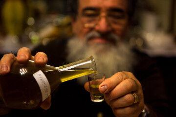 tagAlt.Man pouring homemade liquor 8