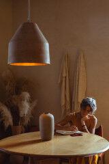 tagAlt.Woman writing at table 5